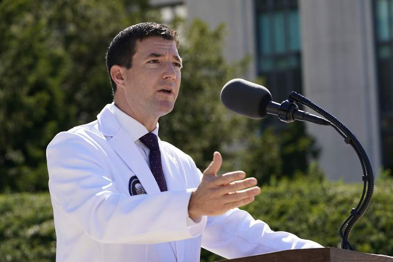 Dr. Sean Conley, physician to President Donald Trump, briefs reporters at Walter Reed National Military Medical Center in Bethesda, Md., Saturday, Oct. 3, 2020. Trump was admitted to the hospital after contracting the coronavirus. (AP Photo/Susan Walsh)