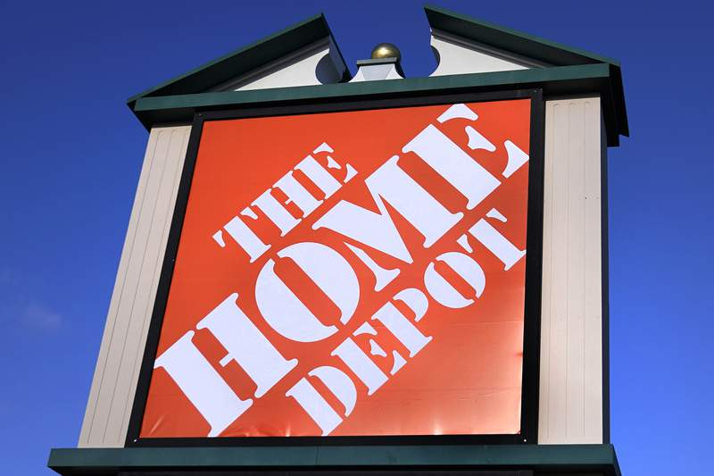 A Home Depot store sign is visible from Route 102, Wednesday, Nov. 18, 2020, in Londonderry, N.H.  Home Depot has reached a $17.5 million settlement with the attorney generals of most U.S. states over a 2014 data breach in which the payment card information of some 40 million customers was exposed. The Massachusetts Attorney Generals office detailed the settlement in a statement Tuesday, Nov. 24.  (AP Photo/Charles Krupa)