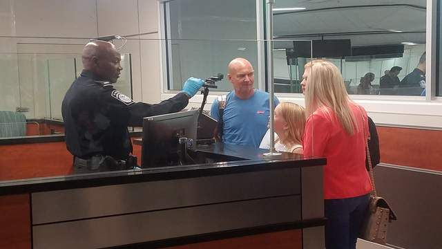 International travelers are scanned by the U.S. Customs & Border Protection (CBP) Biometric Entry and Exit Program facial recognition technology at Orlando International Airport.