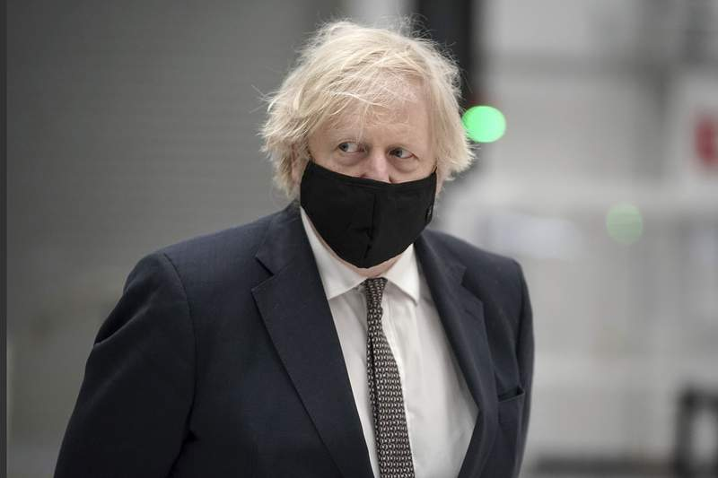 Britain's Prime Minister Boris Johnson walks, during a visit to BAE Systems at Warton Aerodrome in Lancashire, England, Monday, March 22, 2021 to mark the publication of the Integrated Review and the Defence White Paper. (Christopher Furlong/Pool Photo via AP)