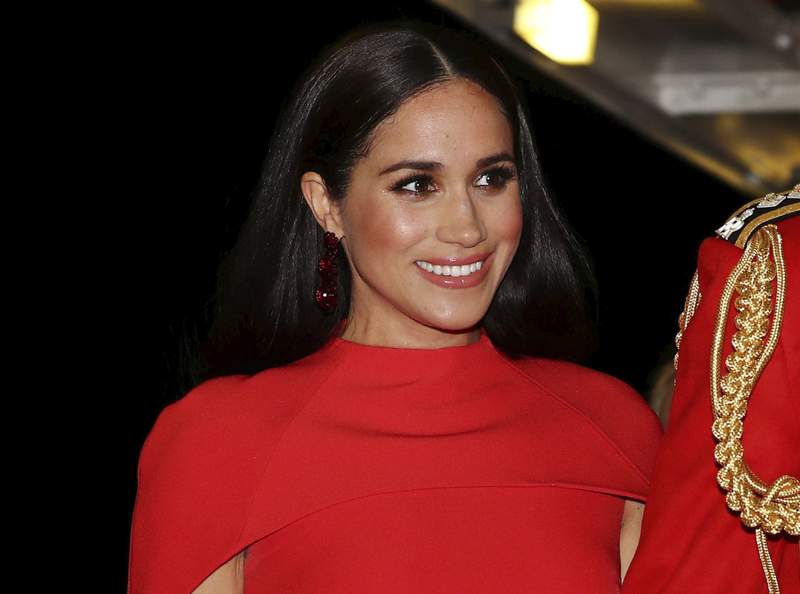 FILE - In this Saturday March 7, 2020 file photo, Meghan, Duchess of Sussex with Prince Harry arrives at the Royal Albert Hall in London, to attend the Mountbatten Festival of Music. A British newspaper doesnt have to run a front-page statement about the Duchess of Sussexs legal victory until it has had the chance to challenge the order, a judge ruled Monday March 22, 2021. (Simon Dawson/Pool via AP, File)