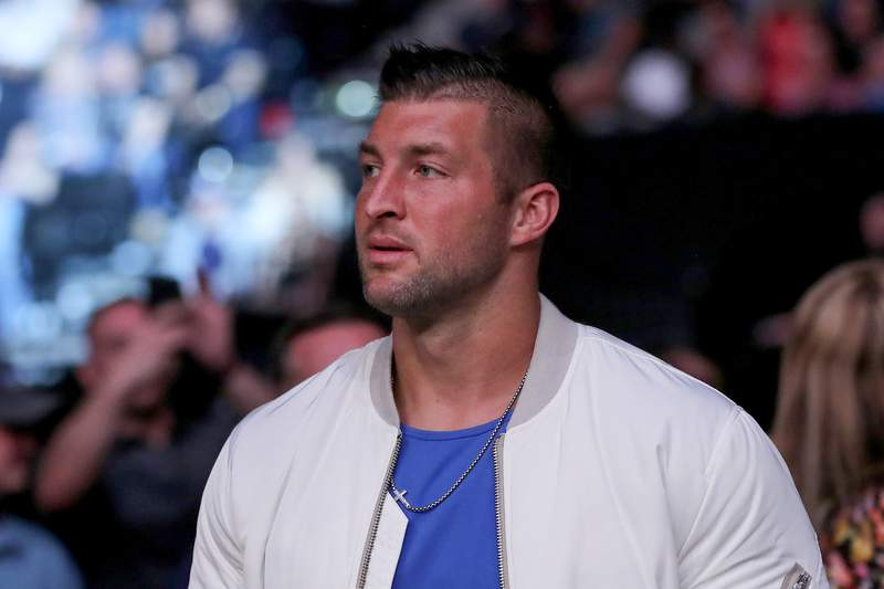 Tim Tebow is seen by the octagon during UFC 261 at VyStar Veterans Memorial Arena on April 24, 2021 in Jacksonville, Florida.  (Photo by Alex Menendez/Getty Images)
