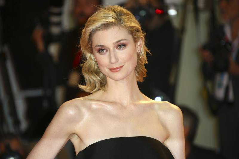 FILE - Actress Elizabeth Debicki poses for photographers upon arrival at the premiere of the film 'The Burnt Orange Heresy' at the 76th edition of the Venice Film Festival, Venice, Italy, in a Saturday, Sept. 7, 2019 file photo.  Elizabeth Debicki will play the Princess of Wales in seasons five and six of The Crown, the Netflix series announced Sunday, Aug. 16, 2020. (Photo by Joel C Ryan/Invision/AP, File)