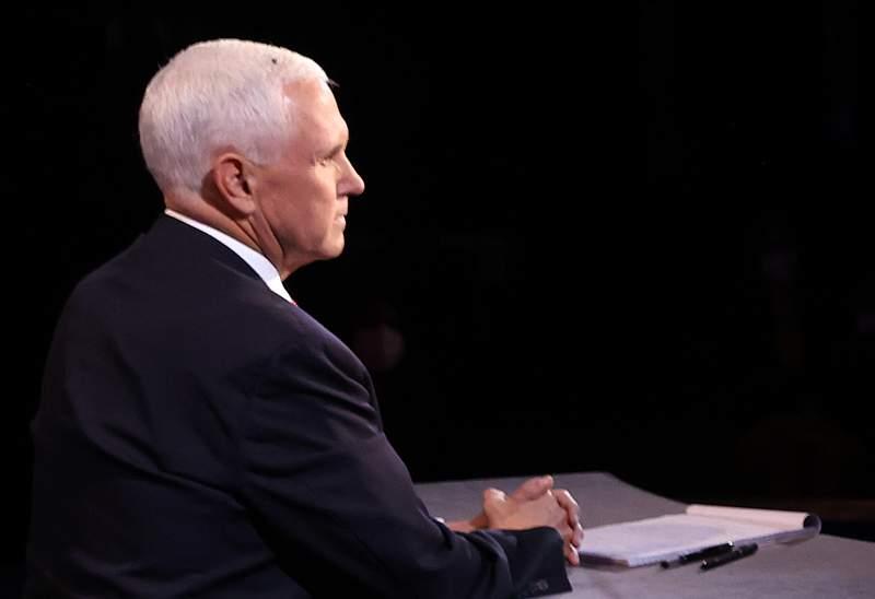A fly briefly lands on head of U.S. Vice President Mike Pence in the vice presidential debate against Democratic vice presidential nominee Sen. Kamala Harris at the University of Utah on Oct. 7, 2020 in Salt Lake City, Utah.
