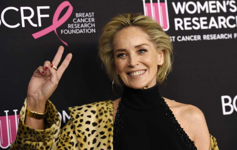 """FILE - In this Feb. 28, 2019, file photo, actress Sharon Stone poses at the 2019 """"An Unforgettable Evening"""" benefiting the Women's Cancer Research Fund, at the Beverly Wilshire Hotel in Beverly Hills, Calif. Stone is criticizing the availability of COVID-19 testing in Montana, where her sister and brother-in-law are hospitalized with the respiratory virus. Stone posted a video on Instagram Sunday expressing frustration that there aren't enough tests for front-line workers and people who have had direct contact with someone who has COVID-19. (Photo by Chris Pizzello/Invision/AP, File)"""