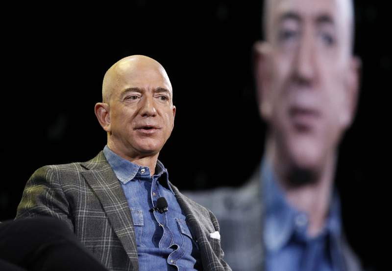 FILE - In this June 6, 2019, file photo Amazon CEO Jeff Bezos speaks at the the Amazon re:MARS convention in Las Vegas.  The Amazon founder officially stepped down as CEO on Monday, July 5, 2021, handing over the reins as the company navigates the challenges of a world fighting to emerge from the coronavirus pandemic. Andy Jassy, the head of Amazons cloud-computing business, replaced Bezos, a change the company had announced in February.  (AP Photo/John Locher, File)