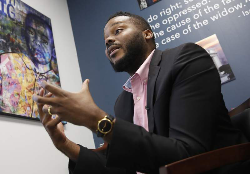 FILE -- In this Wednesday Aug. 14, 2019, file photo Stockton Mayor Michael Tubbs talks during an interview in Stockton, Calif. Mayors across the country are committing to give cash to low-income families with no restrictions on how they can spend it. It's part of a growing movement to establish a guaranteed minimum income as a way to combat poverty and systemic racism. Tubbs, launched one of the country's first guaranteed income programs last year with the help of private donations. (AP Photo/Rich Pedroncelli, File)