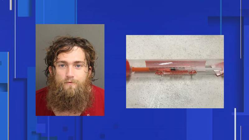 Man accused of trying to stab officers with exposed syringe at Orlando protest