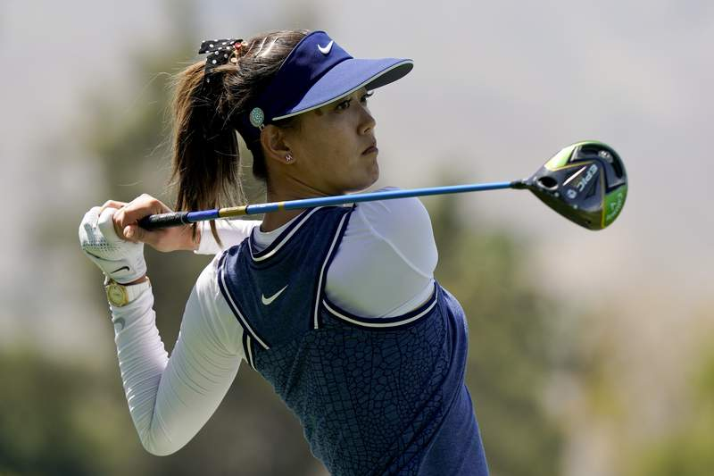 FILE - In this April 5, 2019, file photo, Michelle Wie watches her tee shot on the 18th hole during the second round of the LPGA Tour ANA Inspiration golf tournament at Mission Hills Country Club in Rancho Mirage, Calif. Once a child prodigy who competed against the men, Michelle Wie West is now a mother. The 30-year-old Wie and Golden State Warriors executive Johnnie West announced the birth of their daughter on Instagram on Friday, June 19, 2020. (AP Photo/Chris Carlson, File)