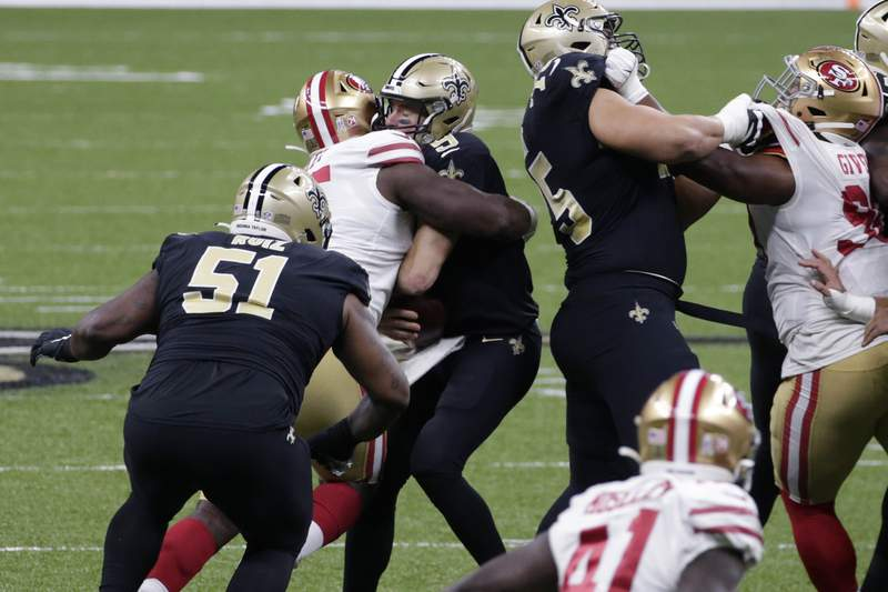 FILE - In this Nov. 15, 2020, file photo, San Francisco 49ers defensive end Kentavius Street (95) sacks quarterback Drew Brees (9) during the first half of an NFL football game in New Orleans. The Saints placed Brees on injured reserve Friday, Nov. 20, meaning he'll miss at least three games with rib injuries. Brees was unable to finish last Sunday's game after absorbing a heavy hit on a sack attempt by 287-pound San Francisco defensive tackle Street, who was penalized for roughing on the play. (AP Photo/Butch Dill, File)