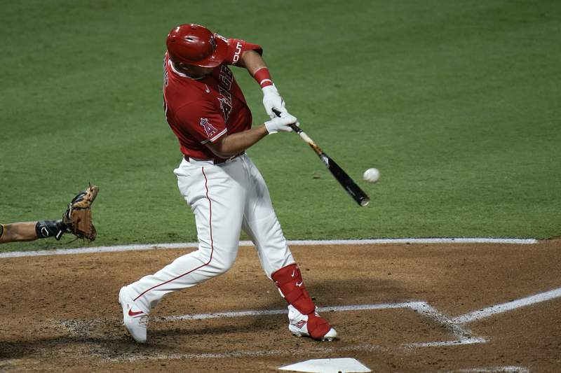 Los Angeles Angels' Mike Trout hits a two-run home run during the third inning of a baseball game against the San Diego Padres, Wednesday, Sept. 2, 2020, in Anaheim, Calif. (AP Photo/Jae C. Hong)