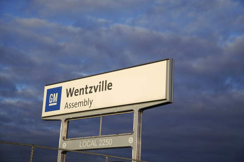 In this March 24, 2021 photo, a sign stands near an entrance to a General Motors assembly plant in Wentzville, Mo.  U.S. factory production in July posted the strongest gain in 4 months, reflecting a surge in production at auto plants that are still confronting major supply chain problems. The Federal Reserve reported Tuesday, Aug. 17,  that manufacturing output increased 1.4% in July following  decline of 0.3% in July. (AP Photo/Jeff Roberson)