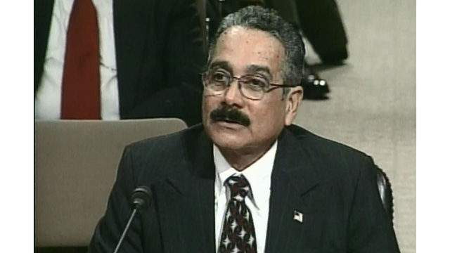Jose Melendez-Perez, testifying before the 9/11 Commission in 2004. The Orlando Border Patrol agent is credited with stopping the 20th hijacker before the Sept. 11, 2001 terrorist attacks. (File photo/WKMG)