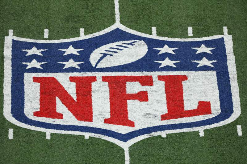 FILE - This Monday, Nov. 2, 2020 file photo shows the NFL logo at a stadium in East Rutherford, N.J. Thousands of retired Black professional football players, their families and supporters are demanding an end to the controversial use of race-norming to determine which players are eligible for payouts in the NFLs $1 billion settlement of brain injury claims, a system experts say is discriminatory. (AP Photo/Adam Hunger, File)