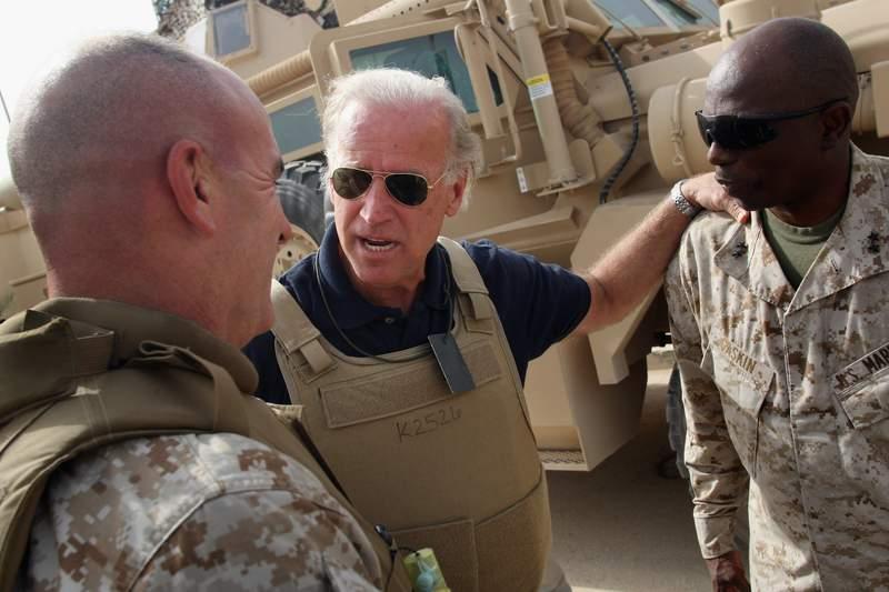 Joe Biden visiting troops in 2007. (Photo by John Moore/Getty Images)