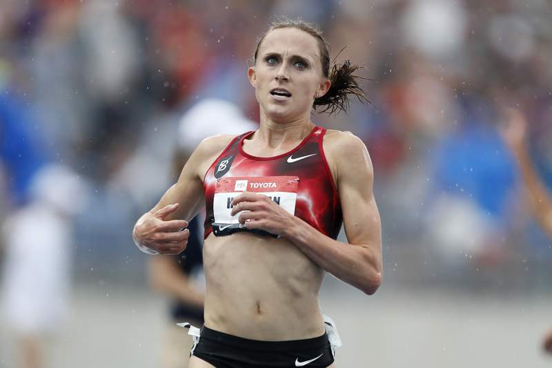 FILE - In this Sunday, July 28, 2019, file photo, Shelby Houlihan crosses the finish line as she wins the women's 5,000-meter run at the U.S. Championships athletics meet, in Des Moines, Iowa. Houlihan, the American record holder in the 1,500 and 5,000 meters, posted on social media that shes been banned for four years following a positive test for what she concluded was a tainted pork burrito. Houlihan said she received an email from the Athletics Integrity Unit (AIU) on Jan. 14, 2021, notifying her that a drug testing sample returned a finding for the anabolic steroid nandrolone. (AP Photo/Charlie Neibergall, File)