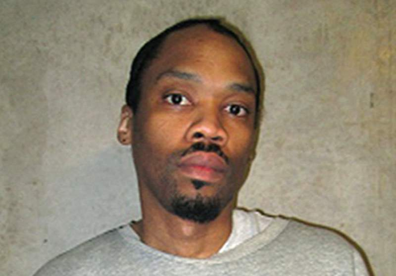 FILE - This Feb. 5, 2018, file photo provided by the Oklahoma Department of Corrections shows Julius Jones. The Oklahoma Supreme Court has rejected a request to remove two state Pardon and Parole Board members from a high profile death penalty case. The court on Friday, Sept. 10, 2021 denied a prosecutor's request to remove Adam Luck and Kelly Doyle from considering the commutation request of condemned killer Julius Jones. (Oklahoma Department of Corrections via AP, File)
