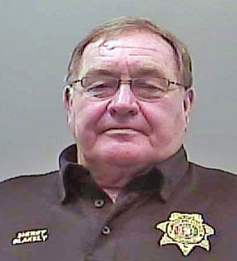 FILE - This Aug. 22, 2019, file photo provided by the Limestone Sheriff's Office shows Sheriff Mike Blakely following his arrest on theft and ethics charges, in Athens, Ala. Speaking with the media on Tuesday, Oct. 5, 2021, Blakely gave glowing reviews to the Limestone County Jail, where he spent time in custody even though he ran it for decades. (Limestone County Sheriff's Office via AP, File)
