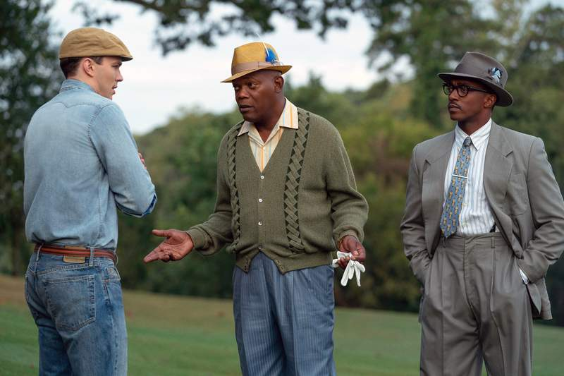 """This image released by Apple TV Plus shows, from left, Nicholas Hoult, Samuel L. Jackson and Anthony Mackie in a scene from The Banker."""" Apple has canceled the premiere of one of the tech companys first original films, The Banker the day before it was to debut at Los Angeles AFI Film Festival.  In a statement Wednesday, Apple said that it learned of some concerns surrounding The Banker and that it needs some time to look into these matters. An Apple spokesperson declined to elaborate.  (Apple TV Plus via AP)"""