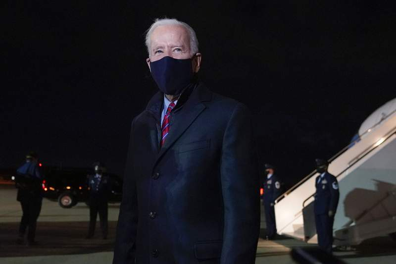 President Joe Biden speaks with reporters after stepping off Air Force One at New Castle Airport in New Castle, Del., Friday, Feb. 5, 2021. Biden is spending the weekend at his home in Delaware. (AP Photo/Patrick Semansky)