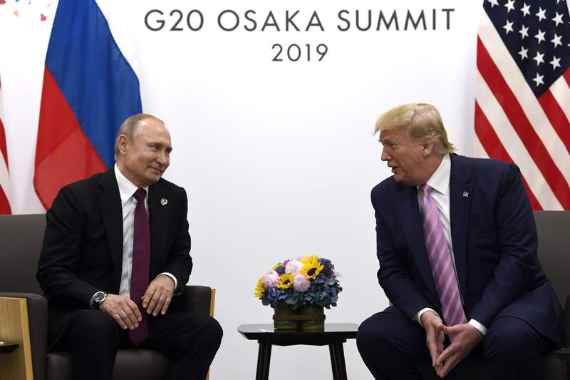 FILE - In this June 28, 2019, file photo, President Donald Trump, right, meets with Russian President Vladimir Putin during a bilateral meeting on the sidelines of the G-20 summit in Osaka, Japan. The U.S. and Russia have agreed to start arms control talks this month as the only remaining treaty between the two largest nuclear powers is poised to expire in less than a year, Marshall Billingslea, the presidents special envoy for arms control, said Monday, June 8, 2020.  (AP Photo/Susan Walsh, File)