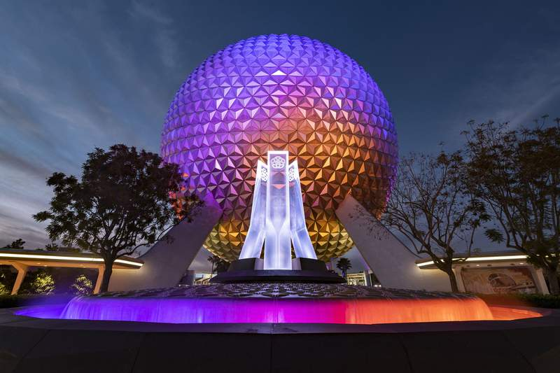A reimagined fountain at the main entrance of EPCOT shines in front of Spaceship Earth at Walt Disney World Resort in Lake Buena Vista, Fla., Dec. 22, 2020.