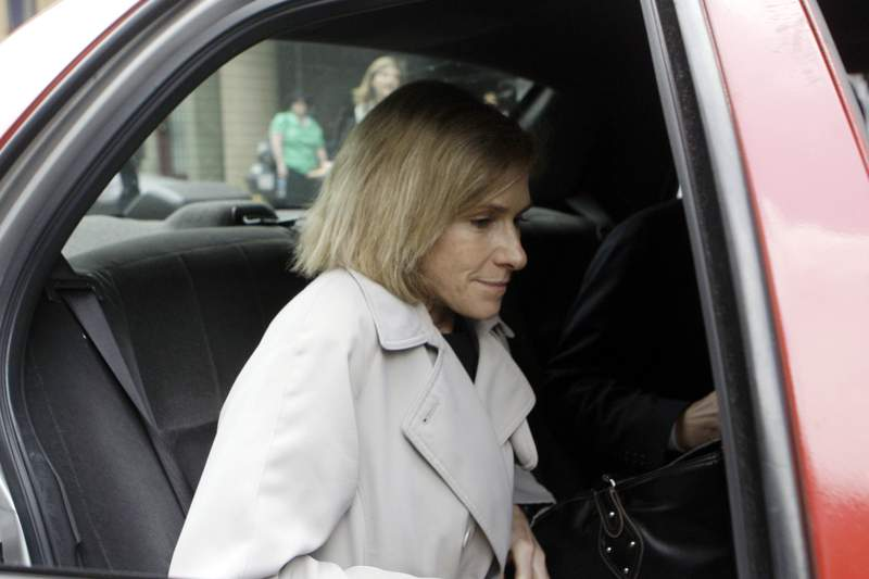 FILE - In this May 15, 2009, then-acting U.S. Attorney Nora Dannehy leaves law offices in Washington. Dannehy, a federal prosecutor who was helping lead the investigation into the origins of the Trump-Russia probe has resigned from the Justice Department.  (AP Photo/Haraz N. Ghanbari, File)
