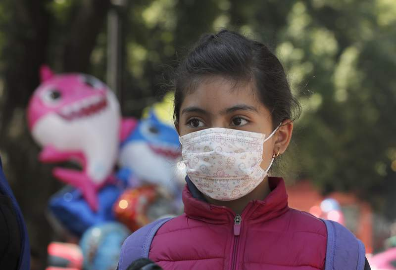 A child wears a medical mask as a precaution against the spread of the new coronavirus, during an outing in Mexico City, Saturday, Feb. 29, 2020. Mexicos Health Department said late Friday that a new case had been confirmed in Mexico City, adding to the first two confirmed cases announced earlier that day.  (AP Photo/Marco Ugarte)