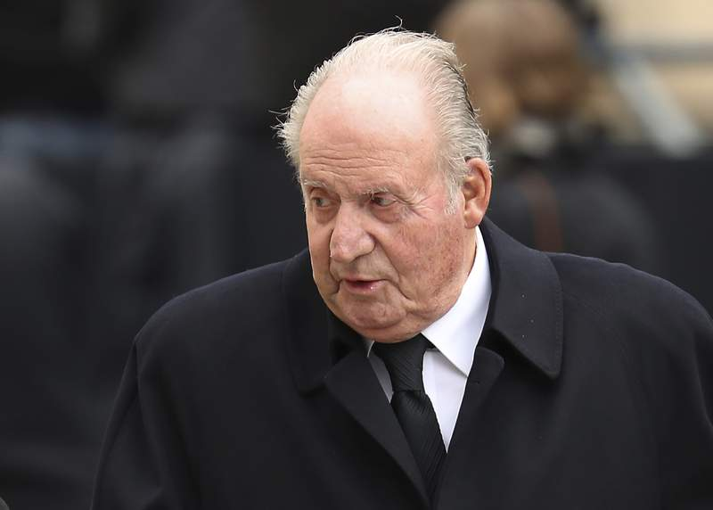 FILE - In this Saturday, May 4, 2019 file photo, Spain's former King Juan Carlos, leaves the Notre Dame cathedral after attending at the funeral of the Grand Duke Jean of Luxembourg, in Luxembourg.  The law firm representing Juan Carlos I said Wednesday Dec. 9, 2020, that the former monarch has paid off a debt of nearly 680,000 euros (dollars 821,000) following a voluntary declaration of previously undisclosed income to Spains tax authorities.  (AP Photo/Francisco Seco, FILE)