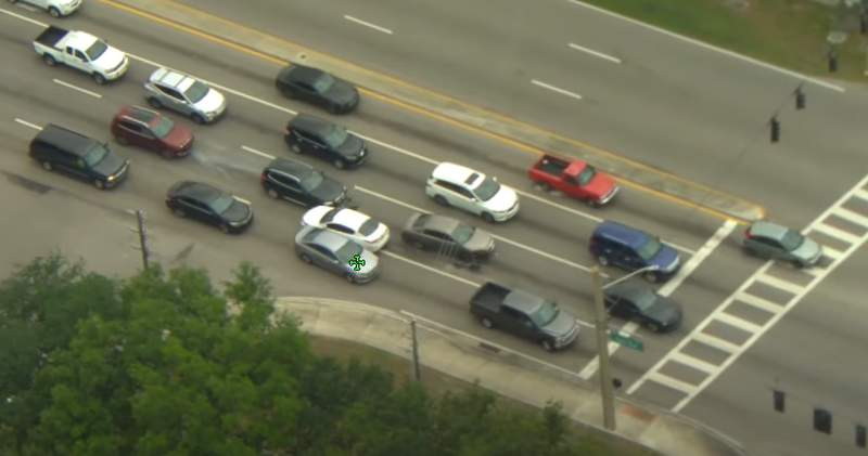 Video from the Volusia County Sheriff's Office shows a driver fleeing police and sideswiping cars in traffic.