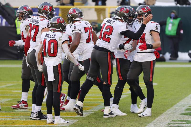 Tom Brady #12 celebrates with Cameron Brate #84 of the Tampa Bay Buccaneers after Brate scored a touchdown in the third quarter against the Green Bay Packers. Photo by Stacy Revere
