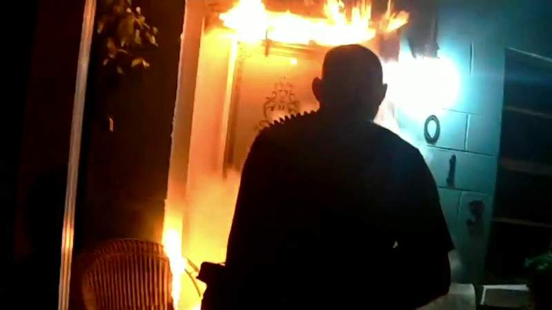 Video shows Ocala officer kicking in door to save woman, puppy after suspected arson fire