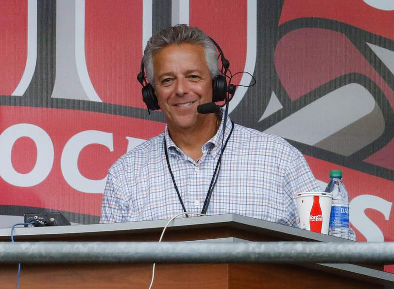 FILE - In this Sept. 25, 2019, file photo, Cincinnati Reds broadcaster Thom Brennaman sits in a special outside booth before the Reds' baseball game against the Milwaukee Brewers in Cincinnati. Brennaman used a gay slur during the broadcast of Cincinnati's game against the Kansas City Royals on Wednesday, Aug. 19, 2020. Brennaman used the slur moments after the Fox Sports Ohio broadcast returned from a commercial break before the seventh inning in the first game of a doubleheader. Brennaman did not seem to realize he was already on air. (AP Photo/John Minchillo, File)