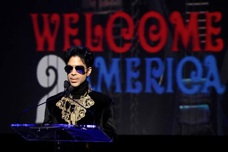 "FILE - In this Oct. 14, 2010 file photo, musician Prince holds a news conference at The Apollo Theater announcing his ""Welcome 2 America"" tour in New York. The ongoing controversy over the money left behind by Prince when he died without a will is heating up again after Internal Revenue Service calculations showed that executors of the rock star's estate undervalued it by 50%, or about $80 million. (AP Photo/Peter Kramer, File)"