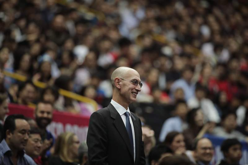 FILE - In this Oct. 8, 2019 file photo, NBA Commissioner Adam Silver is introduced during an NBA preseason basketball game between the Houston Rockets and the Toronto Raptors in Saitama, near Tokyo.  Silver said in an interview Saturday, March 21, 2020  that the league is considering all options, best-case, worst-case and countless ideas in between,  as it tries to come to grips with the coronavirus pandemic. (AP Photo/Jae C. Hong, File)