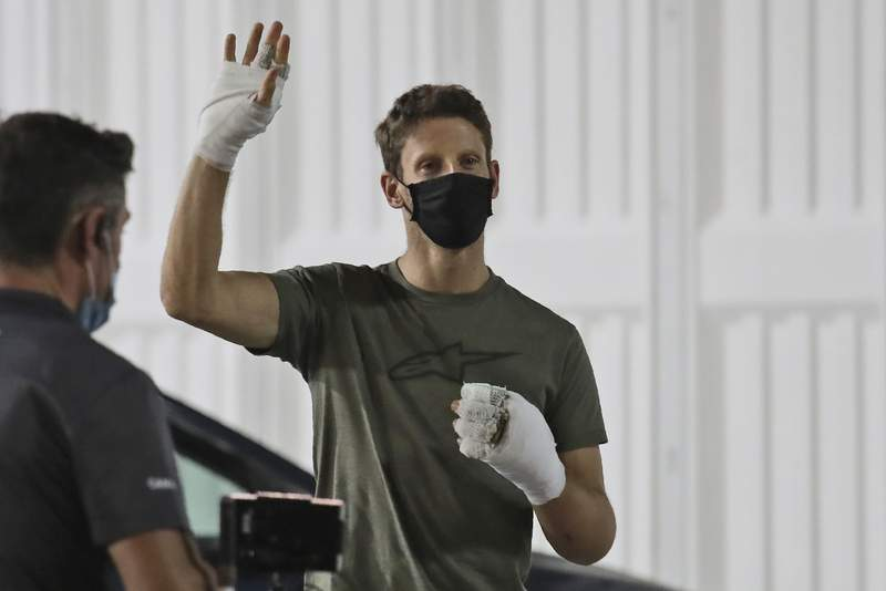 Haas driver Romain Grosjean of France waves Thursday, Dec. 3, 2020, at Bahrain International Circuit in Sakhir, Bahrain. Grosjean escaped with only minor burns when his Haas car exploded into a fireball after crashing on the first lap at last weekend's Bahrain GP. (AP Photo/Kamran Jebreili)