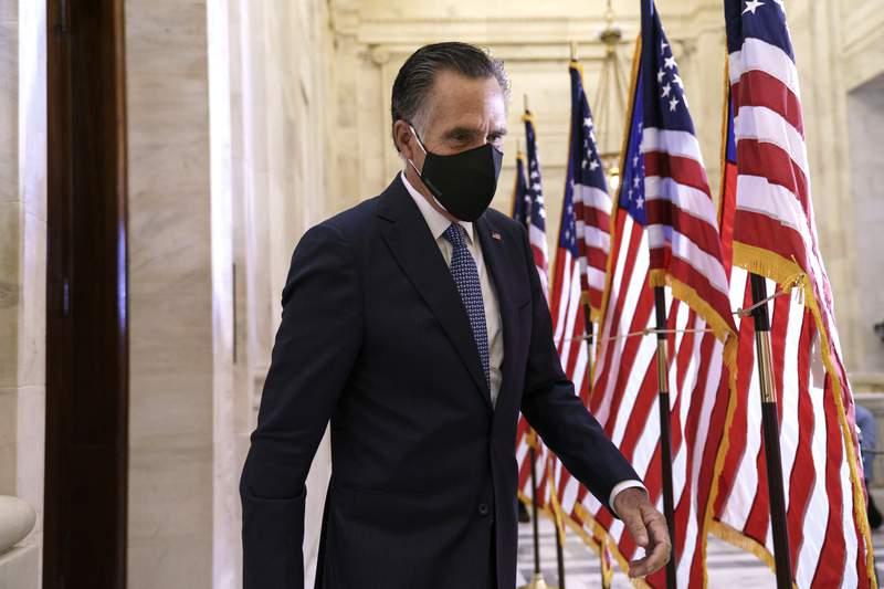 Sen. Mitt Romney, R-Utah, departs after the Republican Conference held leadership elections, on Capitol Hill in Washington, Tuesday, Nov. 10, 2020. (AP Photo/J. Scott Applewhite)