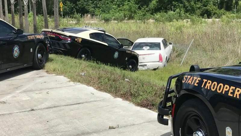 Nearly naked Florida woman leads troopers on high-speed chase in stolen car, officials say