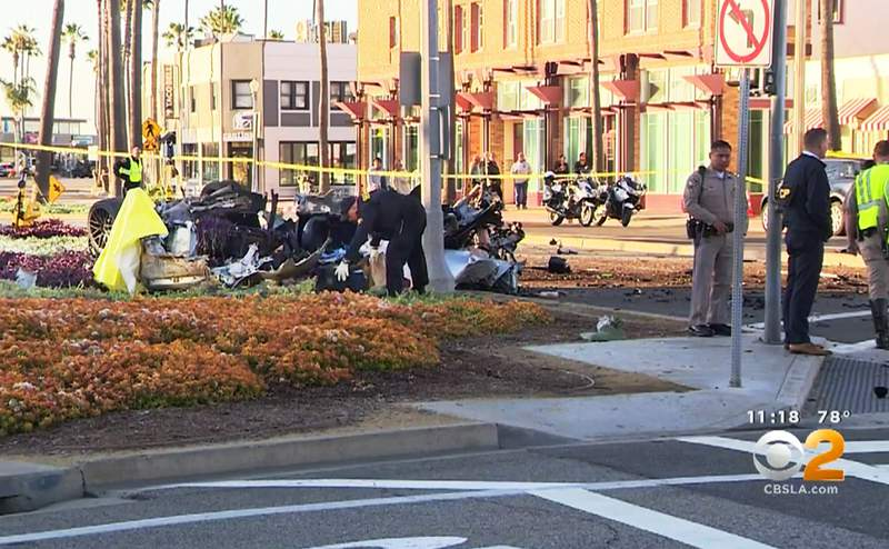 This photo from video provided by KCBS/KCAL shows the wreckage of a car that crashed at high speed on Balboa Avenue in Newport Beach, Calif., early Tuesday, Sept. 3, 2020. The driver died in the crash; a female passenger was slightly injured. Authorities said the crash was so violent that the car's engine landed 100 yards away from the car. (KCBS/KCAL via AP)