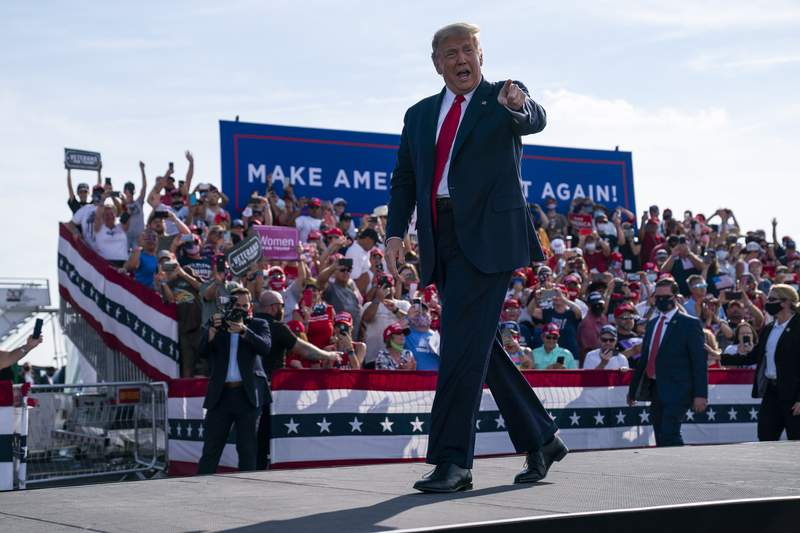 President Donald Trump arrives to speak to a campaign rally at Ocala International Airport, Friday, Oct. 16, 2020, in Ocala, Fla. (AP Photo/Evan Vucci)