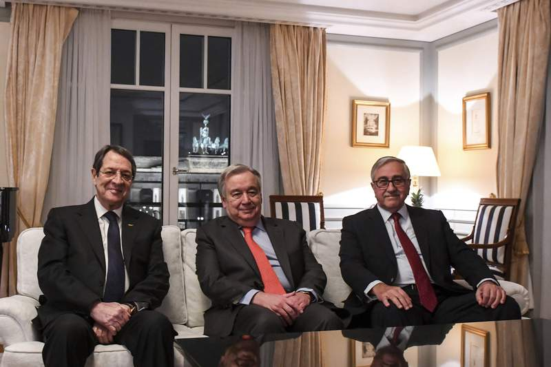 This photo provide from the United Nations shows the Secretary-General Antonio Guterres, center, sits with Greek Cypriot President Nicos Anastasiades, left, and Turkish Cypriot leader Mustafa Akinci, right, during an informal meeting in Berlin, Germany, on Monday, Nov. 25, 2019. Guterres hosted the meeting in hopes of unlocking the way forward to restarting talks to reunify ethnically divided Cyprus. (UN Photo/Tobias Hofsaess via AP)