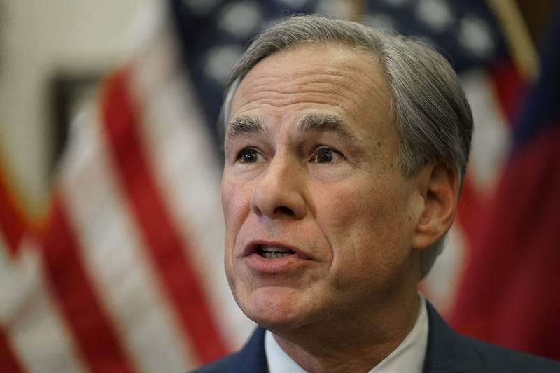 FILE - In this June 8, 2021, file photo, Texas Gov. Greg Abbott speaks at a news conference in Austin, Texas. Texas Democrats are starting a second week of holing up in Washington to block new voting laws back home. A reality is fast creeping in: the difficulty of sustaining attention and pressure on Congress with 17 days still left to run out the clock on a sweeping elections bill in Texas, which Abbott says he will keep reviving for as long as it takes. (AP Photo/Eric Gay, File)