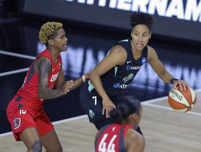 FILE - In this Sept. 3, 2020, file photo, New York Liberty's Layshia Clarendon (7) is defended by Atlanta Dream's Courtney Williams (10) during the first half of a WNBA basketball game in Bradenton, Fla. Clarendon, who identifies as transgender and nonbinary, announced on social media Friday, Jan. 29, 2021, that they had surgery to remove breast tissue. (AP Photo/Mike Carlson, File)