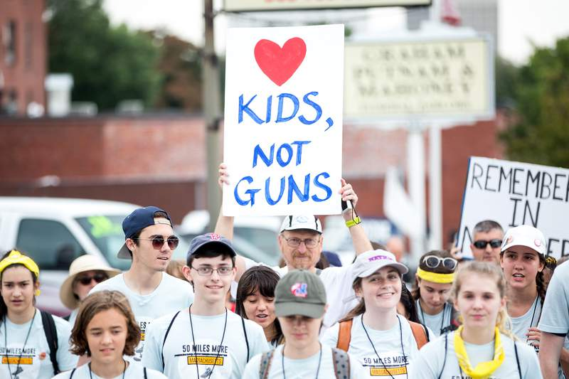 Parkland Shooting survivor and activist David Hogg, third from left, walks during the 50 Miles More walk against gun violence which will end with a protest at the Smith and Wesson Firearms factory on Aug. 23, 2018 in Worcester, Massachusetts.