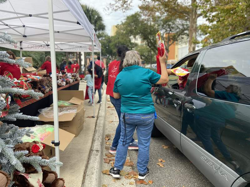 Scenes from the Dec. 16, 2020 Salvation Army Angel Tree distribution day on Orange Avenue in Orlando as families pick up their gifts.
