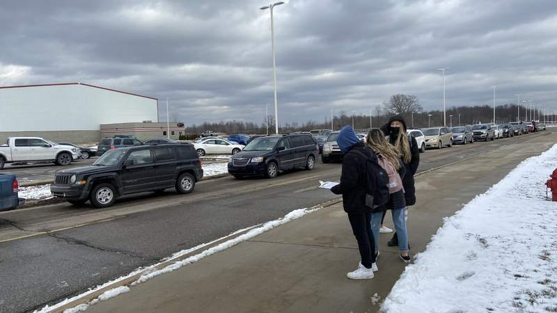 A group of students conduct a seat belt observation test at New Baltimore Anchor Bay High School. Contributed photo