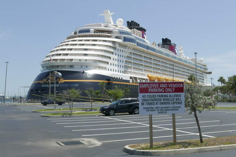 Due to the coronavirus, a Disney cruise ship is docked at Port Canaveral Saturday, April 4, 2020, in Cape Canaveral, Fla. Disney cruises are suspended till further notice. (AP Photo/John Raoux)