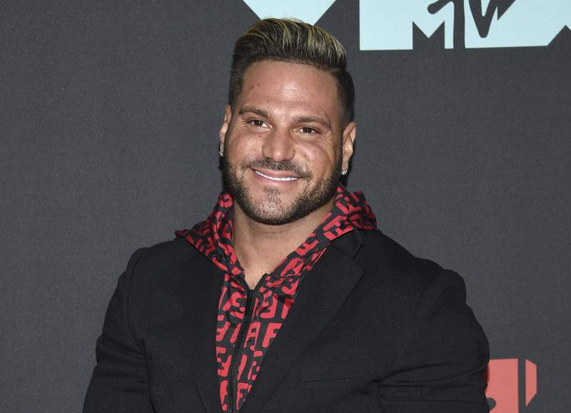 """FILE - This Aug. 26, 2019 file photo shows """"Jersey Shore"""" cast member Ronnie Ortiz-Magro at the MTV Video Music Awards in Newark, N.J. Ortiz-Magro was arrested Thursday, April 22, 2021 for investigation of felony domestic violence, police said Ortiz-Magro, was arrested in the coastal Playa Del Rey section of Los Angeles. Police would give no details on the victim, but said Ortiz-Magro was arrested on suspicion of violating the California law covering violence against intimate partners. (Photo by Evan Agostini/Invision/AP, File)"""