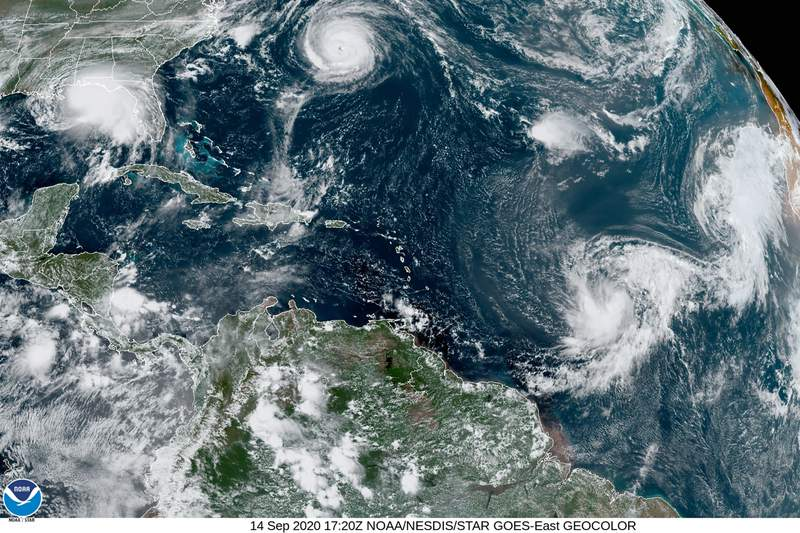 This satellite image provided by the NOAA shows five tropical cyclones churning in the Atlantic basin at 5:20 p.m. GMT on Monday, Sept. 14, 2020. The storms, from left, are Hurricane Sally over the Gulf of Mexico, Hurricane Paulette over Bermuda, the remnants of Tropical Storm Rene, and Tropical Storms Teddy and Vicky. (NOAA via AP)