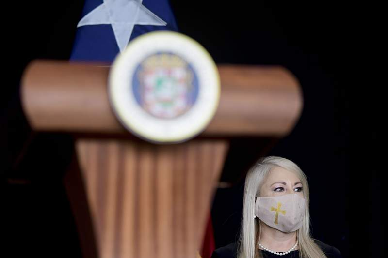 FILE - In this May 21, 2020 file photo, Gov. Wanda Vazquez, wearing a protective face mask amid the new coronavirus pandemic, attends a press conference, in San Juan, Puerto Rico. Vazquez announced Wednesday, Aug. 19, 2020, that she will place the U.S. territory on a 24-hour lockdown every Sunday as part of stricter measures to fight a spike in COVID-19 cases. (AP Photo/Carlos Giusti, File)